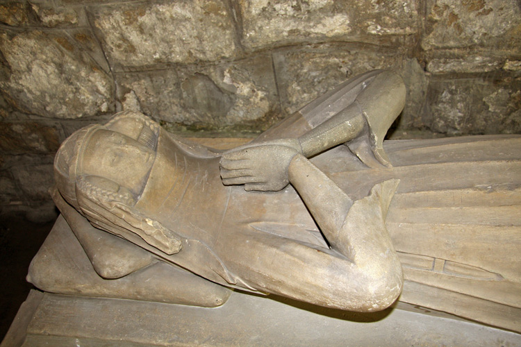 CHANCEL: one effigy of girl 1300 - 1350, probably Lady Amy Ryder (or Ryther). She could be related to the knight in Ryther church. It is quite likely that this effigy was originally in the ogee niche under the large transept window.