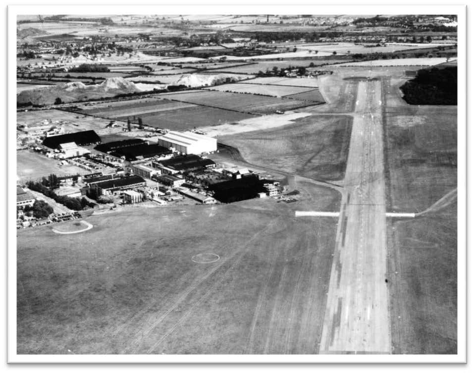 This aerial view is taken from the west and shows the runway and airfield. Hucknall is one of the oldest airfields in the country that has seen continuous use since it was built in 1916 – a PDF outlining its history is available here . Notable firsts accomplished at Hucknall were the first flight of the Merlin installed in a Mustang, the world's first turboprop flight by the Trent Meteor and the world's first manned jet-borne operation by the Rolls-Royce Thrust Measuring Rig (TMR) or more widely known as the 'Flying Bedstead'. Many Lightning pilots became very familiar with this airfield
