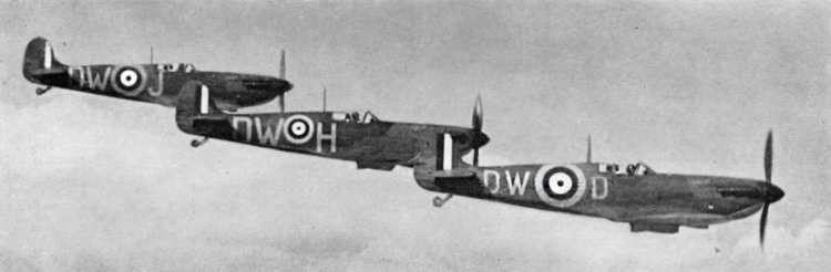 Spitfire Mk. Is of No. 610(F) Squadron seen (probably) during late May 1940. The leading aircraft has had the Type A 35in. roundel outlined in Yellow producing a roundel of 49in. overall diameter. The second aircraft has the standard 35in. roundel, resulting from the painting of the Yellow outer ring around the existing 25m. Type. The leading aircraft is unusual in having 30in. code letters.