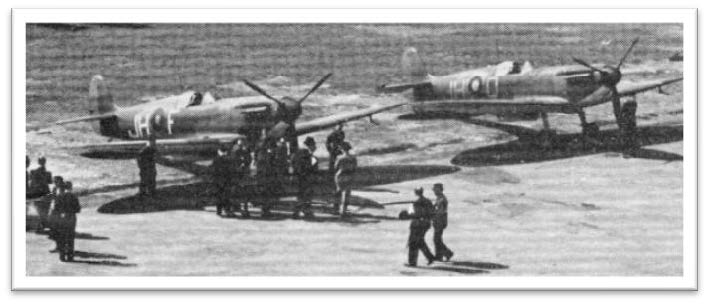 Spitfire Mk. 1s of No. 74(F) Squadron at Northolt in May 1939. The port wigs have been painted in Night, but the starboard wings are still in the original delivery scheme of Aluminium.