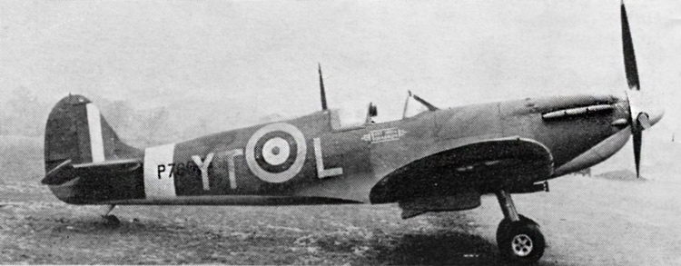 Spitfire Mk. IIA of No. 65(F) Squadron. This photograph was probably taken after 22nd April, 1941, when under surfaces reverted to Sky. Port wing previously Night. 7in. wide Pinstripes; Type A.1 fuselage roundel 35in., 50in. Type A under wing roundel.