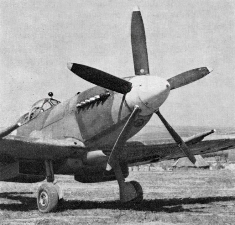 Spitfire Mk. XIV of' No. 610(F) Squadron. The aircraft letter under nose is painted in Medium Sea Grey on a black circle.