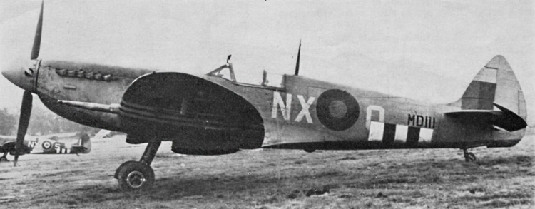 Spitfire Mk. VII, MDI I/, of No. 131(F) Squadron. High altitude day fighter scheme introduced 7th June, 1943. Code and aircraft letters in Sky Grey. 30in. Type B fuselage roundel, 24in. square fin flash. The invasion stripes are of incorrect size, being approximately 10in. wide on both black and white. (R. C. Jones).
