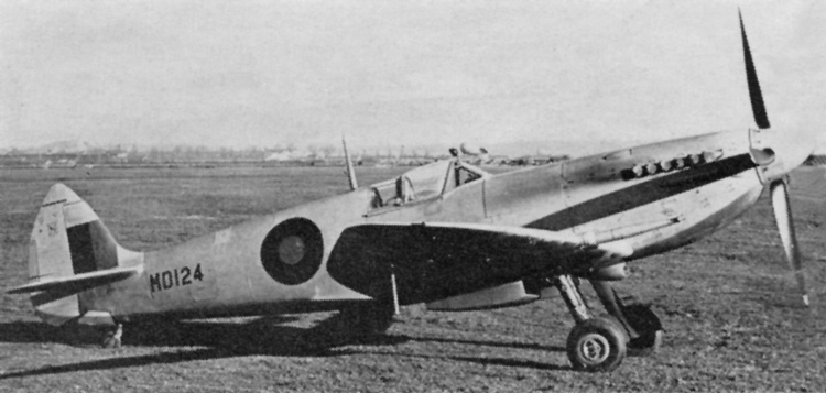 Spitfire H.F.Mk. VII in standard high altitude day fighter finish introduced 7th June, 1943. Upper surfaces Medium Sea Grey, under surfaces P.R.U. Blue. 30in. diameter Type B fuselage roundel and 24in. square fin flash.