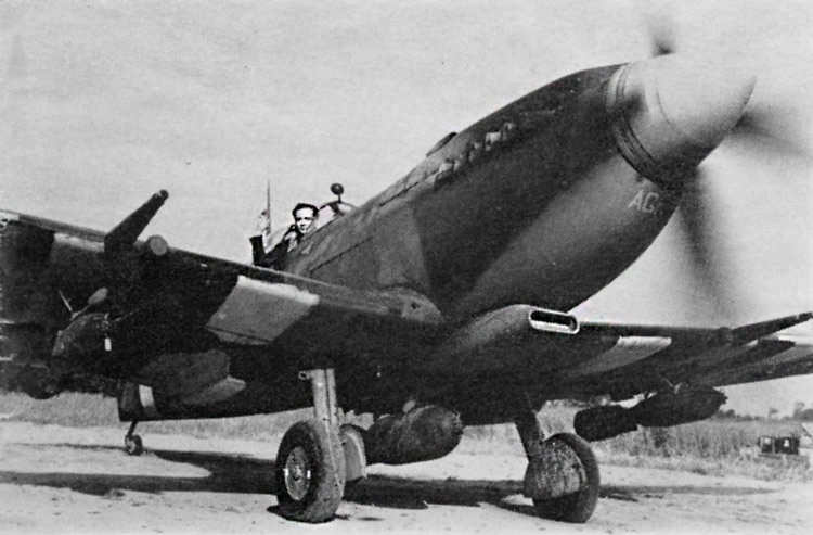 Spitfire F.Mk. IXE flown by Wing Commander A. G. Page. This photograph shows the crudely-painted l8in. 'Invasion Stripes'. The Wing Commander's pennant can be seen beneath the windscreen, and the pilot's initials are painted in Sky under the nose. Medium Sea Grey under surfaces.