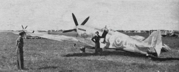 Spitfire Mk. XIV of No. 402 Squadron, 2nd Tactical Air Force. The Sky spinner has been repainted 'black' and the Sky 18in..fuselage band over painted in the standard camouflage colours. Type C upper wing roundel outlined in Yellow used during the final phases of' war.