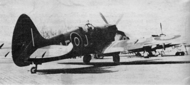 Spitfire Mk. XIV of No. 41(F) Squadron, on the Continent. Black spinner, Sky fuselage band overpainted in normal camouflage colours. Type C upper wing roundel of 56in. diameter introduced on production Spitfires after 9th March, 1945.