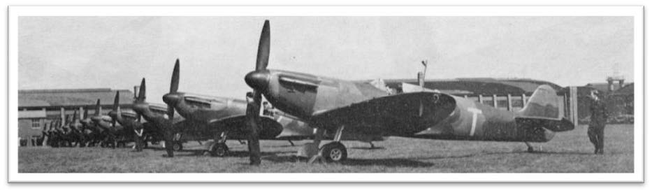 Spitfire Mk. Is of No.19(F) Squadron. The foreground aircraft has B-scheme camouflage, the next A-scheme camouflage. Both have White undersides to the port ailerons. The painted-out Yellow ring on the fuselage, and serial number, can he clearly seen. Photo below shows Black ailerons on White wing.