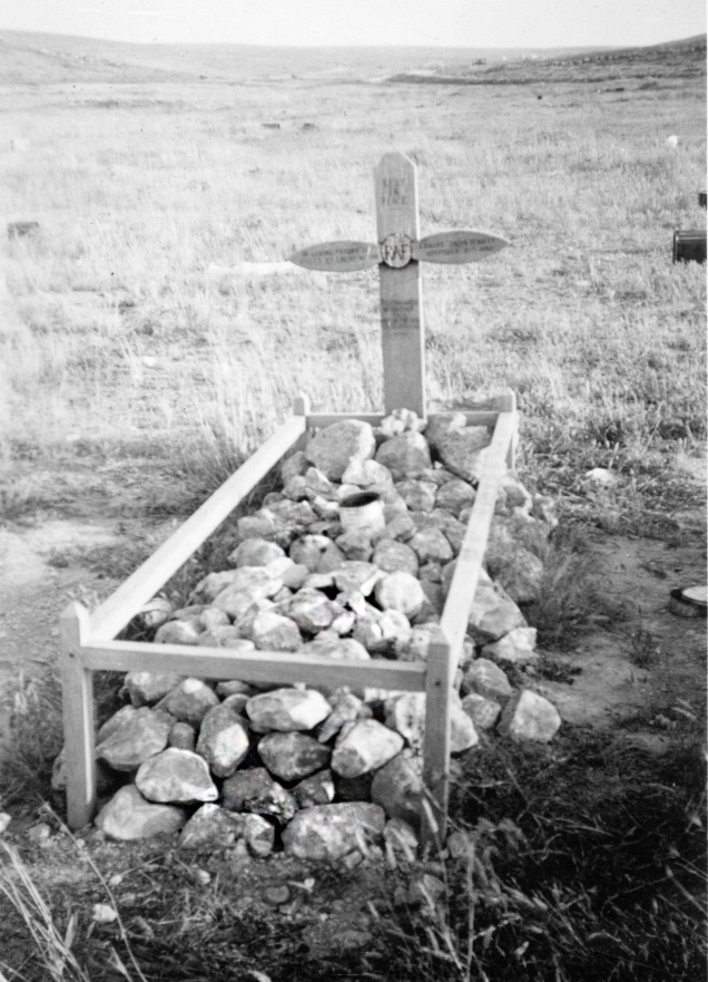 Grave of South African pilot near his crashed aircraft. Beautifully kept in its isolated position.